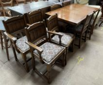 A 20th century oak extending dining table and eight chairs