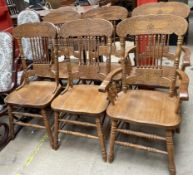 A set of six modern stick back dining chairs,