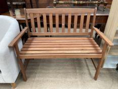 A modern teak garden bench