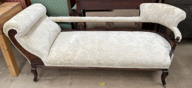 An Edwardian cream upholstered chaise longue