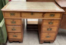 An Edwardian mahogany campaign style desk,
