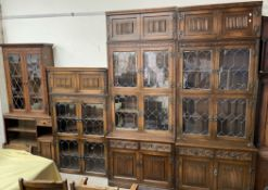 A 20th century oak wall unit with multiple sections,