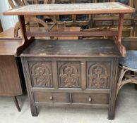 A mid 20th century teak tiled top coffee table together with a 20th century oak coffer
