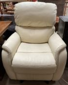 A cream leather electric recliner chair