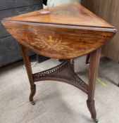 A Victorian inlaid rosewood table of triangular shape with drop flaps on three legs united by an