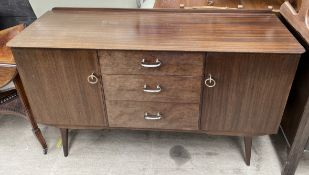 A mid 20th century dark teak sideboard, bears a trade label for Sutcliffe,