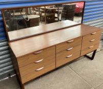 A mid 20th century Europa furniture teak effect dressing table with a rectangular mirror and nine