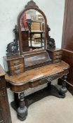 A Victorian walnut dressing table with an arched mirror, piano front compartment and six drawers,