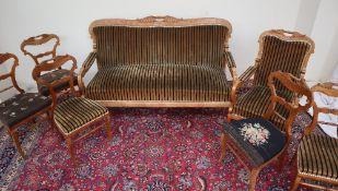 A Biedermeier style salon suite comprising a three seater settee,