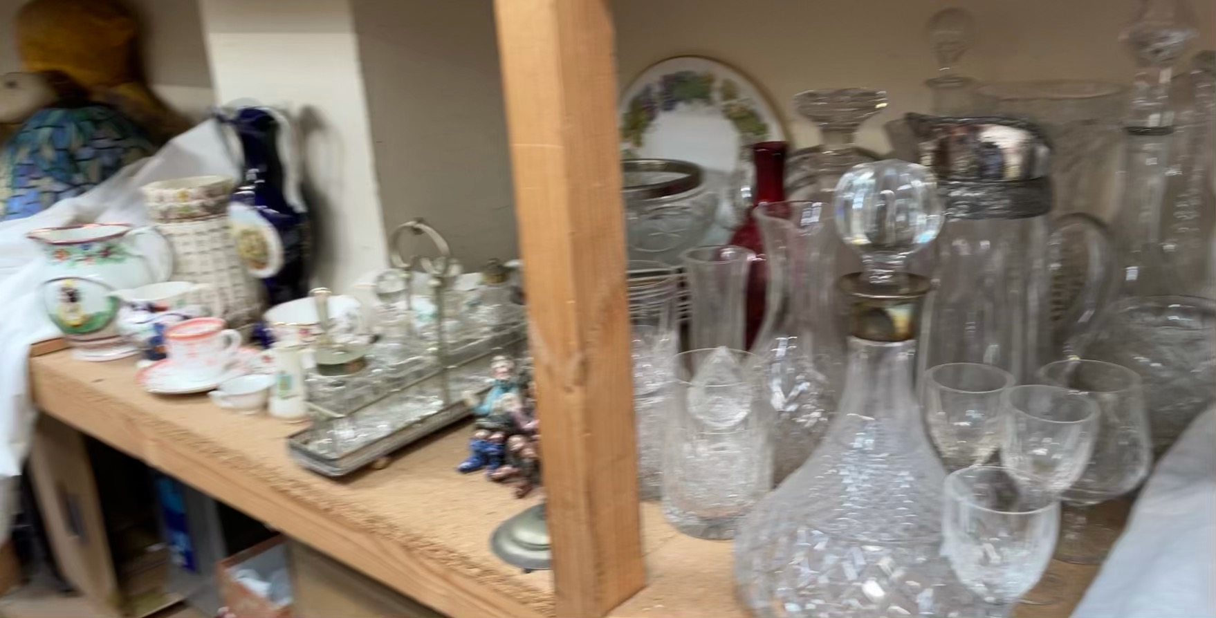 A silver topped and glass ships decanter together with other decanters, drinking glasses,