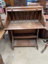 An early 20th century oak desk, with a tambour front,