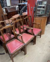 A set of six George III style dining chairs,