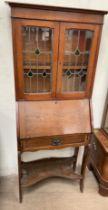 A 20th century oak bureau bookcase,