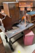 A 20th century oak drawleaf dining table together with an oak pot cupboard, a mahogany work table,