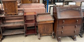A Victorian walnut Davenport together with an oak bureau, bookcase,