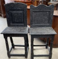 A matched pair of carved ebonised back stools,