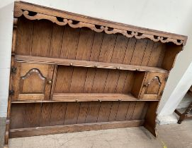 An oak dresser rack, with two shelves and two cupboards,