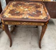 An inlaid Italian games table, with a removable top, revealing a backgammon board, chess board,
