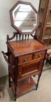 An Edwardian mahogany washstand, with an adjustable octagonal mirror,