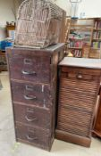An oak tambour fronted filing cabinet together with another filing cabinet and a wicker basket