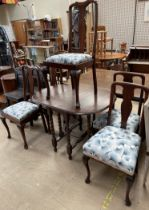 A 20th century oak drop leaf dining table together with a matched set of five Queen Anne style