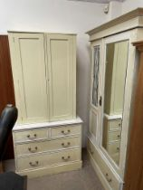 An Edwardian wardrobe, painted yellow with blue and terracotta highlights,