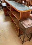 An oak work table together with a bookcase