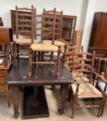 An early 20th century oak extending dining table together with a set of five ladder back dining