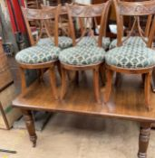 An early 20th century extending dining table on reeded legs together with a set of six continental