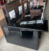 Pierre Vandel - a high gloss black dining table,