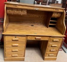 A Victorian style serpentine tambour fronted desk, by Country Desk,