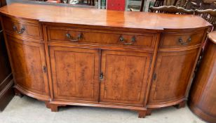 A 20th century yew sideboard