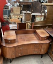 A mid 20th century teak dressing table,