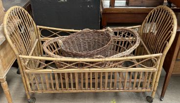 A bamboo child's cot together with a Moses basket and a twin handed basket