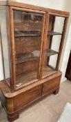 A 20th century walnut display cabinet,