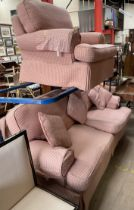 A pink and cream upholstered two piece suite comprising a three seater settee and an armchair