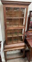 A 20th century oak display cabinet,