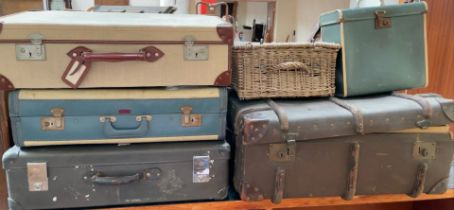 A banded trunk together with three suitcases,