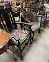 A 19th century carved oak elbow chair,