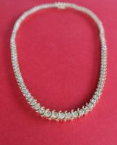 A 14ct yellow gold diamond set necklet set with one hundred and five round brilliant cut diamonds,