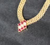 A 14ct yellow gold ruby & diamond necklace,