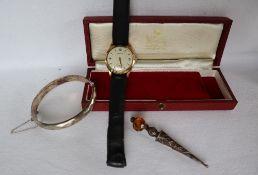 A Gentleman's 9ct yellow gold Garrard wristwatch,