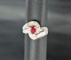 An 18ct white gold ruby and diamond ring,