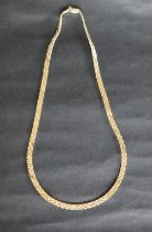 A 14ct yellow gold necklace, with three rows of rectangular links, 42.