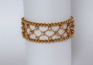 An 18ct yellow gold diamond set bracelet, with forty five round brilliant cut diamonds, 18cm long,
