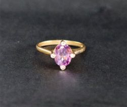 A 9ct yellow gold amethyst set ring, with an oval faceted amethyst, claw set,
