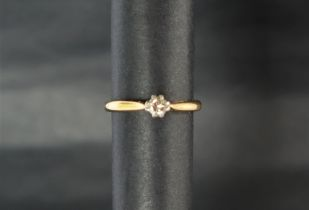 A solitaire diamond ring. the round brilliant cut diamond approximately 0.