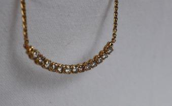 A 14ct yellow gold diamond set necklace,