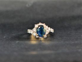 A sapphire and diamond ring, the oval faceted sapphire,