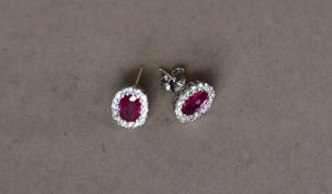 A pair of ruby and diamond earrings,